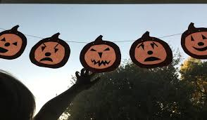 we bloom here jack o lantern window garland