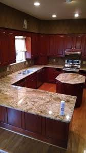 Granite Kitchen Countertops Pictures by Backsplash With Typhoon Bordeaux Granite Typhoon Bordeaux
