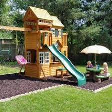 Backyard Playground Plans by Mulch Wood Wooden Playset Swings Plastic Slide And Loads Of Fun
