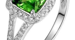 2 carat gold engagement ring ring beautiful 2 carat cushion cut emerald and halo