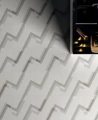giulio iacchetti lays out a labyrinth of flooring tiles for