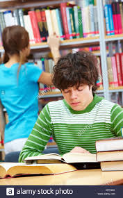 classmate book reading book while his classmate looking for a