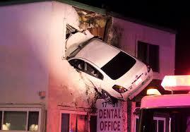 floor in car flies into 2nd floor of santa building orange county