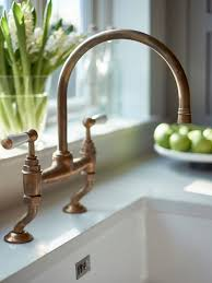 Antique Brass Kitchen Faucet Traditional Antique Brass Kitchen Faucet With Dual Levers With