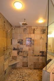 interior shower walk in with decorative tile and seat bench walk