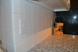 decorating white bullnose tile backsplash with switch plate cover