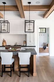 grey kitchen cabinets and black countertops design trend 2019 black kitchen countertops becki owens