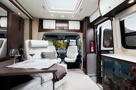 unity motorhome combines murphy bed and swivel recliners in comfy