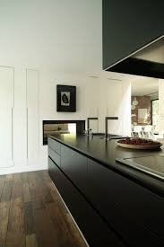 matt black kitchen love the tall pantry cabinets with no handles