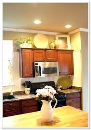 how to decorate top of kitchen cabinets top of cabinet decor ideas musicyou co