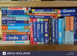travel guides books a stack of travel books on a book shelf covering many popular