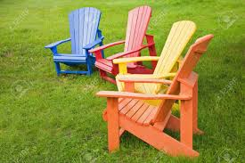 Adirondack Chair Colors A Group Of Adirondack Chairs Painted In Brilliant Colors Stock