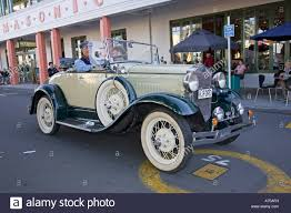 classic vintage ford two seater tourer motor car on road art deco
