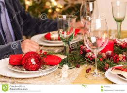 Gold Table Setting by Christmas Table Setting With Holiday Decorations Stock Photography