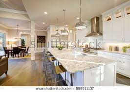 Kitchen Island With Granite Countertop White Kitchen Design Features Large Bar Stock Photo 555911137