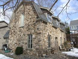 traditional home ferguson estate ice house fieldstone house in