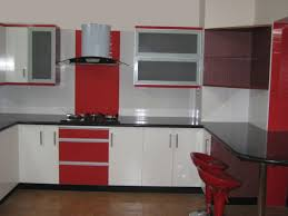 red kitchen designs white and red wooden counter with black top added by white hood