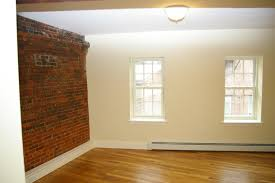 faux brick wall panels with classy luminate flooring to interior
