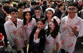 halloween revelers descend on shibuya urged to keep it clean
