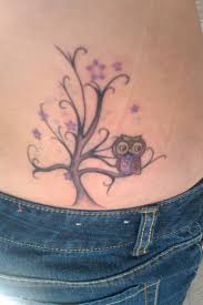 small owl with simple tree on lower back golfian com
