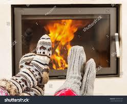 portrait feet woolen socks warming fireplace stock photo 303995120