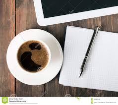 tablet paper notebook and coffee on the table stock photo image