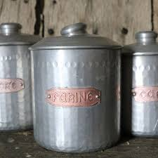 set of french vintage dimpled aluminium kitchen canisters pedlars