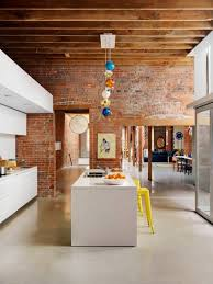 modern rustic kitchen modern rustic kitchen brick wall and white cabinets rustic