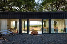 shipping container transforms with walls of glass in argentina