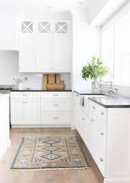 White Kitchen Cabinets And Black Countertops by Black Countertops Cococozy