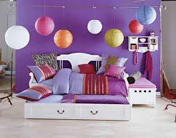 purple wall with white wooden bed having striped pillows on