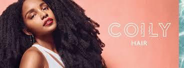 long hair lady coily hair products moisturize coily hair textures