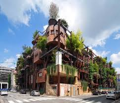 turin apartment building is covered in rusty steel trees sprouting