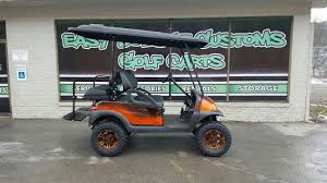electric club car precedent golf cart with custom orange fade body