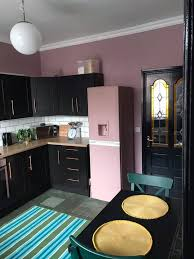 painting kitchen cabinets frenchic the bold pink and black kitchen transformation that cost