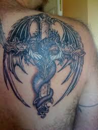 tattoo cross dragon dragon tattoo with cross tattoomagz