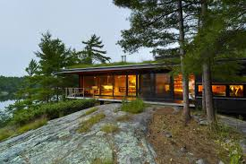 gorgeous vacation home with green roof perches on canadian