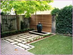inepensive backyard design with large jar and stone teture desain