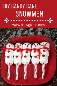 these candy cane marshmallow snowmen make a great craft and snack