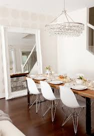 mirrored dining table dining room eclectic with chandelier eames