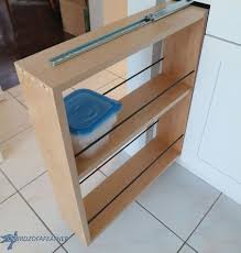 Roll Out Kitchen Cabinet by Hidden Kitchen Storage Turn A Filler Panel Into A Pull Out
