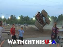 monster truck crash video monster truck almost crashes into crowd at lenewee county fair