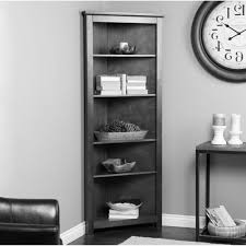 high corner black wooden bookcase with five shelves having