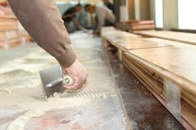 how to install glue engineered wood flooring on concrete