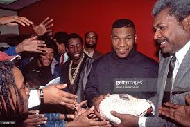 mike tyson and don king distribute turkeys for thanksgiving day