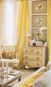 yellow curtains against my blue walls in the living room want