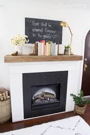 fireplace makeover written by stacy at not just a housewife blog