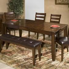 solid mango wood dining table with butterfly leaf by intercon