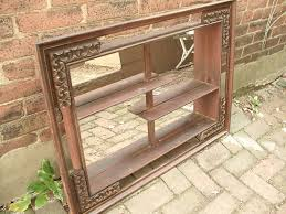 antique mirrored wall shelf