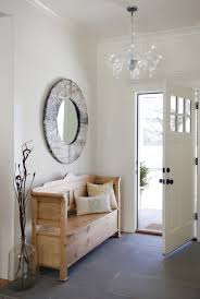 natural unfinished wood small entry bench with big round mirror